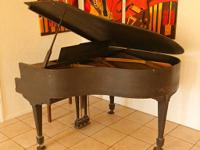 Possess a circa 1920's baby grand piano with excellent