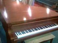 A great baby grand piano being sold by long standing