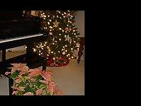 This beautiful black grand piano has set in my home and