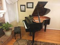 This excellent-condition baby grand (55) has had one