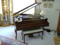 We are selling our Kimball 88 key baby grand piano,