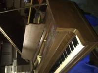 nice baby grand wurlitzer piano. i recently had this