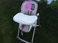 Baby high chair tan with pink flower This ad was posted