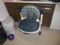 High chair for sale for $25 contact Deloris at