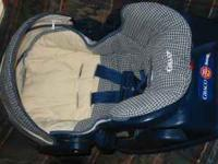 This is a Graco Snug Ride Adjustable car seat with base