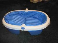 -Newborn to toddler fold-away bath tub. Has an incline