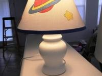 Baby lamp with planet decoration on it, stands 12""