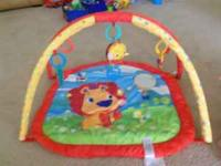 Baby playmat. has mirror for baby to see themself.