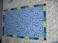 Train tie-on baby quilt. One of a kind. This quilt