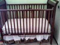 . The crib is made by Simmons with top-notch and