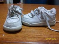 1st pair: white champion size 4 $2.00 2nd pair: black