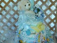 Diaper cake for boy or woman. Every one includes