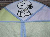 Baby Snoopy bedding. Colors are mostly purple and