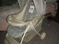 Safety 1st baby stroller, beige, very clean, and in