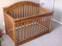 Baby crib that also converts to toddler bed. Solid oak.