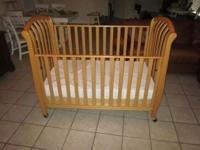 This is a convertible baby/toddler infant crib in mint