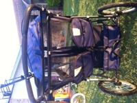 This double jogging stroller is navy blue and in good