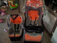 I have an orange and gray baby trend travel system