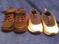 two pairs of baby shoes. 1 is nike brown high tops 1 is