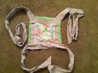 This is a gently used BabyHawk Mei Tai Baby Carrier. It