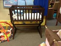 This is a good wooden bassinet that converts into a toy