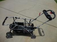 Gently used double infant seat carrier stroller for