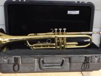 I am selling a brass Bach trumpet in a padded hard