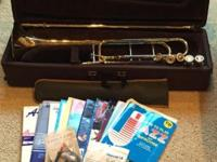 Brass trombone and case: including 5 mouthpieces,