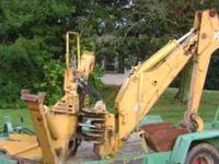 For sale a Vermeer backhoe attachment has over 11'