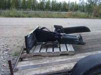 New, still on crate eTerra backhoe. 8 inch bucket with