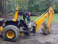 This is a Kelley 3 point B-60 backhoe unit in good
