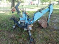 "For sale a ""Woods"" ground breaker backhoe in good"