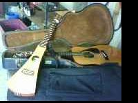 Martin backpacker guitar (on left). Best offer. Call .