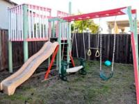 This used outdoor kids slide and swing set made of