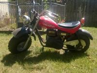 This is a red Baja Mini Bike. it has Black fenders.The