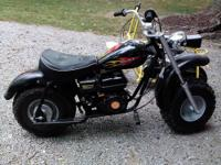 UP FOR SALE IS A BLACK W/FLAMES BAJA MOTOR BIKE WITH A