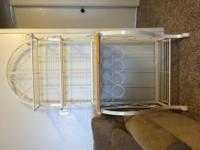 White metal baker's rack with light wood shelf and wine