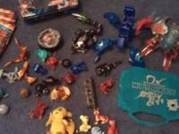 I have 175 Bakugan cards, Bakugans, a tin and a clock