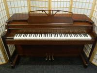 This dark walnut Baldwin Acrosonic makes a fine spinet