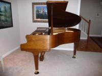 Description This Artist Series Baldwin grand piano