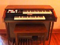 This is a 3.5 octave Baldwin Orgasonic Electric Organ.