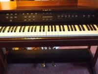 Used upright digital Baldwin Electric Piano. It is a