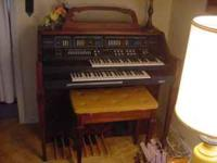 I am offering a like New Baldwin Electronic Organ. This