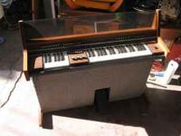 This is indeed a FUN machine. It's a chord organ, with