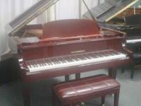 D.H. Baldwin Grand Piano, Cherry/Mahogany cabinet,