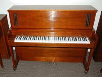 This majestic Baldwin Hamilton upright is in excellent