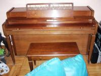 This is a Baldwin Howard spinet piano and bench. The