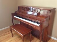 This lovely upright piano has been maintained in
