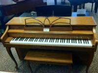 Pretty oak Baldwin Spinet with bench for sale. $1395.00