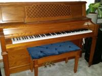 Baldwin limited edition upright oak piano.(2000).